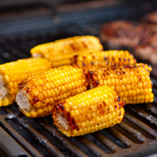 Photo of corn on the cob on a grill