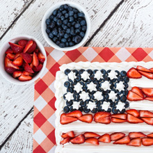 Photo of U.S. Flag cake made with strawberries and blueberries