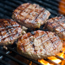 Photo of hamburgers on a grill