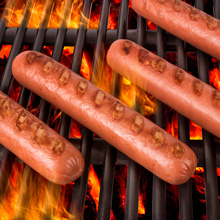 Photo of hot dogs on a grill